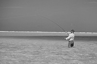 Senior man fishing in lagoon