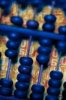 Abacus on circuit board, close-up digital composite