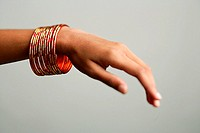 Close-up of woman's hand with bangles