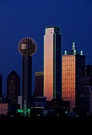 This is the skyline at dusk  It shows the Reunion Tower which is 50 stories high