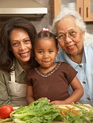Three generation family in kitchen, smiling, portrait