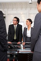 Business colleagues standing during conference call