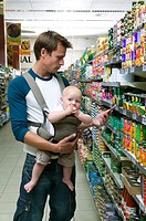 Father shopping with baby girl in supermarket 9-12 months