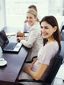 Businesswomen in meeting, smiling