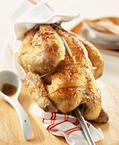 roast chicken stuffed with cream cheese and herbs