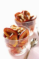 plums with maple syrup and pine seeds