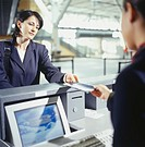 Businesswoman at airport ticketing counter