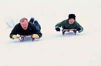 Father Sledding with His Son