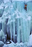 Man climbs an icy wall