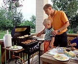 Father and son grilling