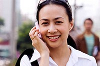 Thailand, Bangkok, Thai woman on cell phone
