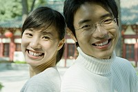 Young couple, back to back, close-up, portrait