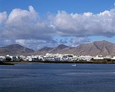 Town at waterfront under cloudy sky, Lanzarote, Canary Islands, Spain