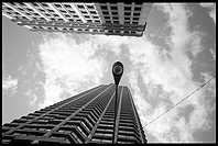 Upward view of tall buildings and a street lamp
