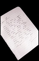 Cursive writing on a piece of looseleaf paper