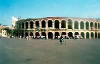 Colosseum in Rome under brilliant blue sky