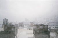 City rooftops on blustery, rainy day´