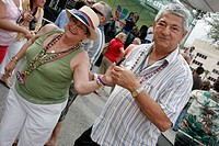 Hispanic senior couple, dance, live entertainment, free concert. Carnaval on the Mile. Coral Gables. Florida. USA.