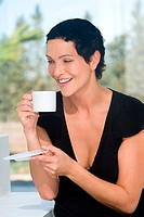 Woman with cup and saucer