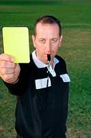 Referre holding yellow card