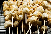 Thailand, Bangkok, unusual delicacies found at street vendor food stalls, skewers of chicken meatballs