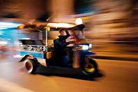 Thailand, Bangkok, A Tuk Tuk speeding down the street