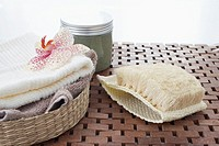 still life of towels in basket and washcloth