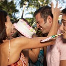 Young Friends Having Food Fight at Birthday Party