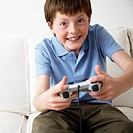 Portrait of Pre-teen Boy Playing Video Game