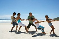 Family Playing Tug of War on the Beach