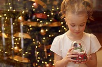 Girl holding a snow globe