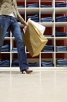 Woman carrying shopping bags in store