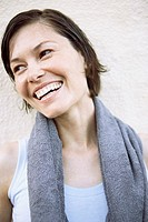 Smiling woman with towel around neck