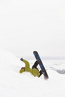 Snowboarder falling