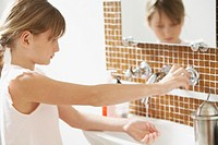 Girl washing hands
