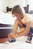 Girl tying sneakers
