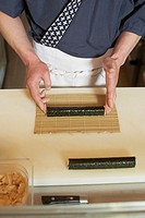 Chef making sushi rolls