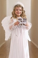 Young girl dressed as a Christmas angel