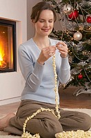 Making popcorn strings at Christmas