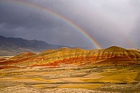 Rainbow over hills, Painted Hills, John Day Fossil Beds National Monument, Oregon, USA
