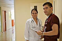 Male doctor standing with a female doctor