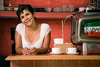 Portrait of a mature woman smiling in a cafe