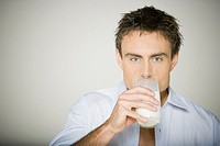 Close up of man drinking milk