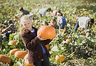 Girl smiling in pumpkin patch