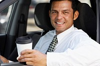 Hispanic businessman in car