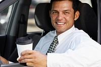 Hispanic businessman in car