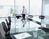 Businessman in boardroom with large windows