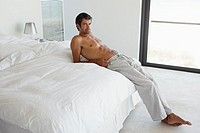 Man reclining on bed