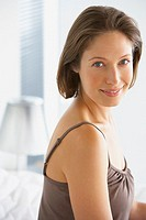 Woman indoors smiling (thumbnail)