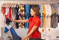 Woman shopping and holding shirt